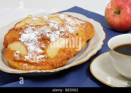 Apple pancake with icing sugar, coffee pot, coffee cup, apples - Stock Photo