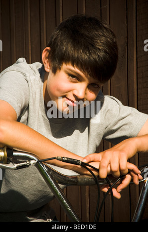 boy boys bike bmx on ride cycle cyclist cycling kid riding kids cool trendy fashionable smile smiling young man - Stock Photo