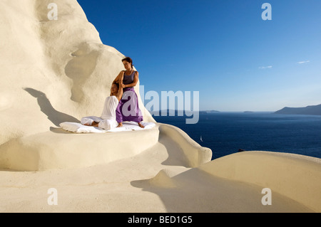 A woman receive a Thai Massage at the luxury hotel Mystique in Oia, Santorini, Cyclades, Greece - Stock Photo