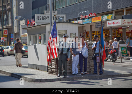 Checkpoint Charlie, former crossing point in Berlin Wall during Cold War, Berlin, Germany - Stock Photo