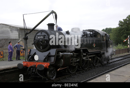 Class 4 Tank Locomotive No. 80151 at the Bluebell Railway being prepared for a steam day - Stock Photo