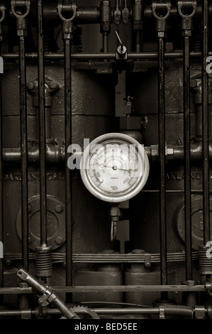 Seen at the Lynden, Washington Antique Machinery Show, the knobs, dial and handle are part of an engine running - Stock Photo