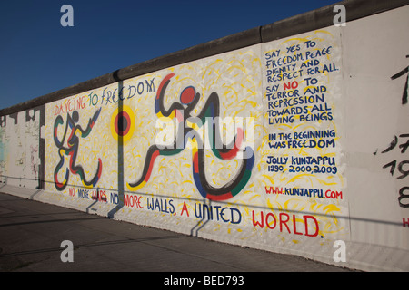 Part of the 'East Side Gallery', the longest surviving remnant of the Berlin Wall, now painted with murals by various - Stock Photo