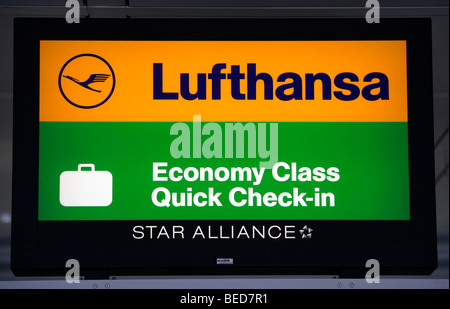 Sign at the Quick-Check-in-Counter of the Lufthansa Economy class, Terminal 2 of Munich Airport, Franz-Josef-Strauss - Stock Photo