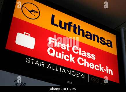 Sign at the Quick-Check-in-Counter of the Lufthansa First Class, Terminal 2 of Munich Airport, Franz-Josef-Strauss - Stock Photo