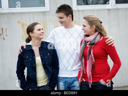 Friendship between three adolescents - Stock Photo
