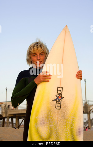 Young Surfer at Huntington Beach Pier, O.C. , CA - Stock Photo