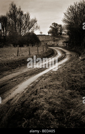 muddy cold country road - Stock Photo