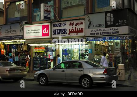 Evening in a shopping street in the historic town centre of Bur Dubai, Dubai, United Arab Emirates - Stock Photo