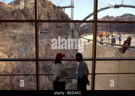 A couple take in the view of the Black Canyon and Colorado River below at the Hoover Dam Visitor Center in Boulder - Stock Photo