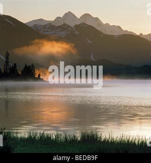Misty arising on Lake Yazevoye and Mount Belukha. The Altai Mountains, Kazakhstan - Stock Photo