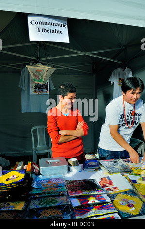 Paris, France - Tibetans Selling Tibetan made products at Exhibit of Tibet Community, in 'Parc de Vincennes', Tibetan Festival, immigrant labor,