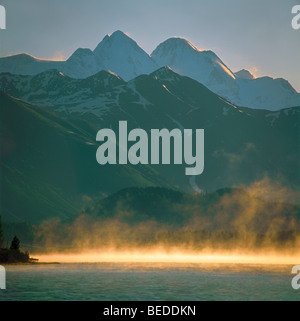 Misty arising on the Yazevoye Lake and Mount Belukha. The Altai Mountains, Kazakhstan - Stock Photo
