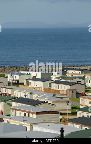rows of static caravans parked in a Caravan park on the Cardigan Bay coast near Barmouth Gwynedd north wales UK - Stock Photo