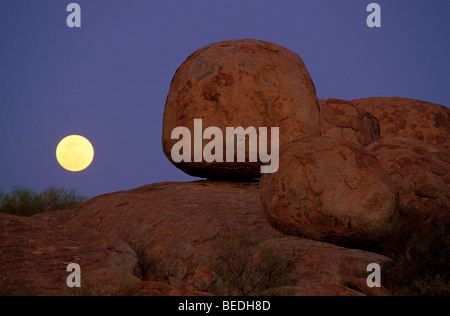 Full moon behind round boulders, Devils Marbles Conservation Reserve, Northern Territory, Australia - Stock Photo