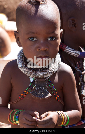 Young boy of the Himba Nomadic Tribe in Damaraland in Northern Namibia - Stock Photo