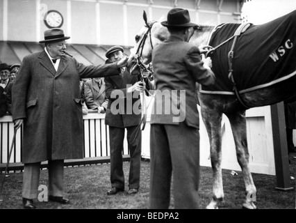 Sir Winston Churchill pets his horse at races