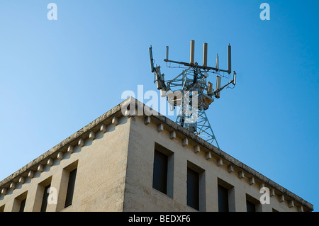 a mobile phone antenna on the roof - Stock Photo