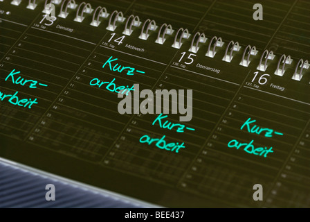 Kurzarbeit, entries in a calendar for reduced working hours - Stock Photo