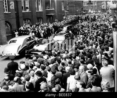 A crowd gathers to see US President John F Kennedy during a visit to London for the christening of his niece in - Stock Photo