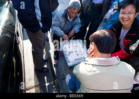 CA Chinatown San Francisco. Men playing board game on Grant Ave. Photo copyright Lee Foster. casanf79366 - Stock Photo