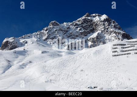 Skiing tracks in deep snow, Rosskopf mountain near Zuers, Vorarlberg, Austria - Stock Photo