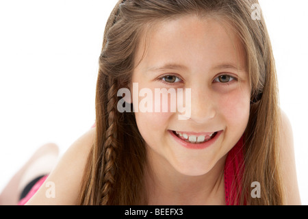 Studio Portrait of Smiling Girl - Stock Photo