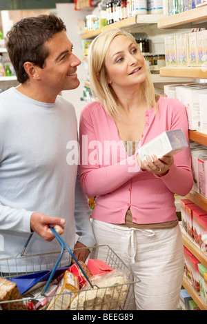 Couple shopping in health food shop - Stock Photo