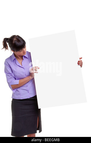 Woman in a shirt and skirt holding a blank sign for you to add your own image or message. - Stock Photo