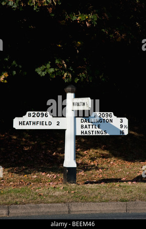 Old style road sign in Sussex England, showing distances to Battle and Hastings. - Stock Photo