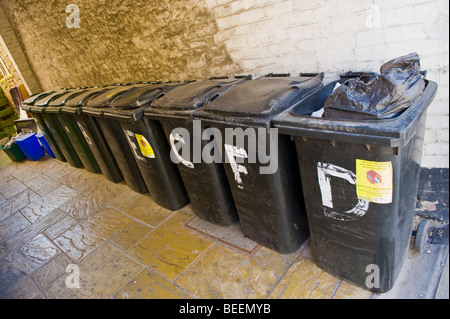 Wheelie bins outside apartments in Ludlow Shropshire England UK - Stock Photo