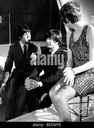 The Beatles with Cilla Black taking a break from filming a TV special - Stock Photo