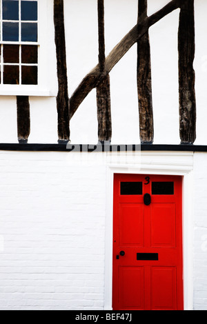 Red Door in Half Timbered House Nayland Suffolk England - Stock Photo