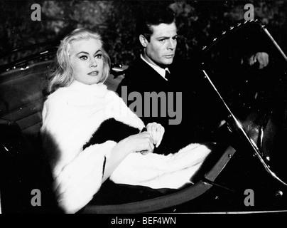 Anita Ekberg and Marcello Mastroianni in a scene from Fellini's 1960 film, 'La Dolce Vita.' - Stock Photo