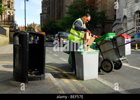 Manchester City council employee emptying rubbish bins in town centre, Manchester, England. - Stock Photo