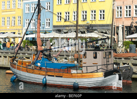 Ships are pictured in Nyhavn, Copenhagen, Denmark in front of colorful buildings on August 6, 2009. - Stock Photo