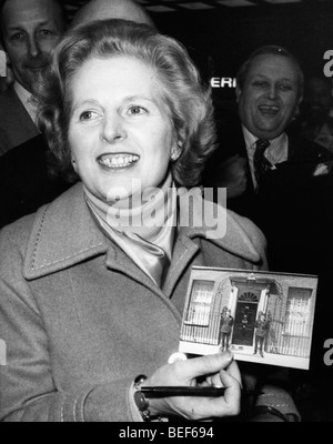 Prime Minister Margaret Thatcher holding picture - Stock Photo