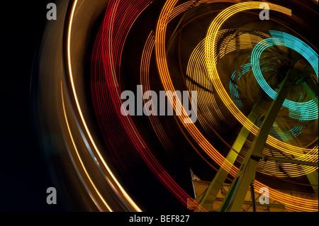 Ferris wheel in motion close up of light streaks Evergreen State Fair Monroe Washington State USA - Stock Photo