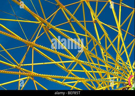 Evergreen State Fair close up of yellow ferris wheel spokes Monroe Washington State USA - Stock Photo