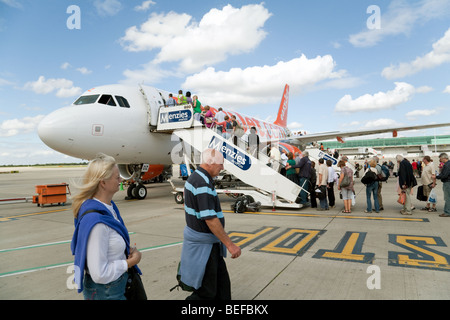 Passengers boarding an Easyjet plane at Stansted airport, UK - Stock Photo