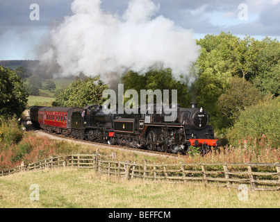 A double headed steam train hauled by BR standard 2-6-0 76079 and SDJR 2-8-0 53809 at Green End on the North Yorkshire - Stock Photo