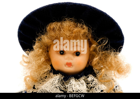 Portrait of an old porcelain doll - Stock Photo