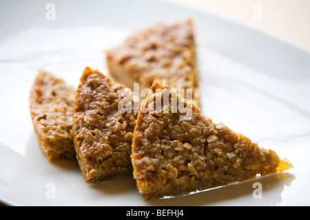 A flap jack on a plate - Stock Photo