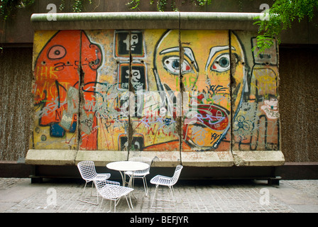 A section of the Berlin Wall on display in a small park on East 53rd Street in New York - Stock Photo
