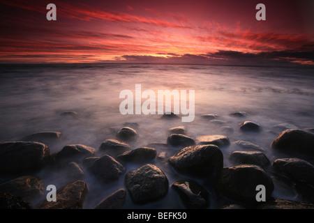 Beautiful sunset by the Oslofjord at Botnerbaugen in Larkollen, Østfold fylke, Norway. - Stock Photo