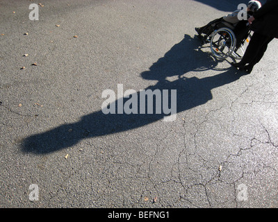 A woman in a wheelchair . Berlin , Germany . - Stock Photo