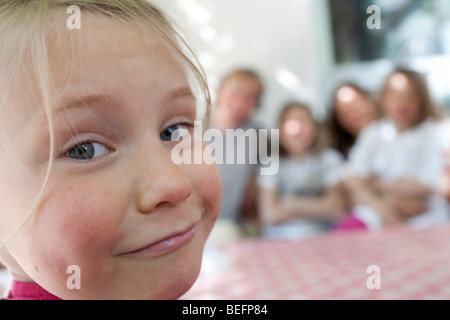 A little girl with family . Bonn , Germany . - Stock Photo