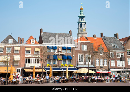 Residential houses at the market square stand in front of Lange Jan (Long John), the abbey tower, in Middelburg - Stock Photo