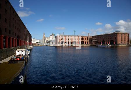 historic warehouses in the basin area at the albert dock liverpool merseyside england uk - Stock Photo