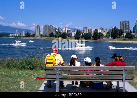 Vancouver, BC, British Columbia, Canada - Family sitting on Bench in Vanier Park, overlooking English Bay and West - Stock Photo